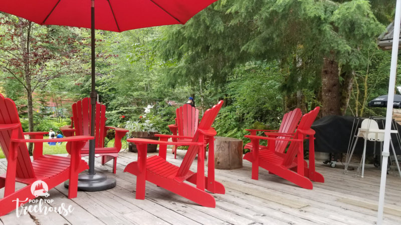 red camping chairs on deck
