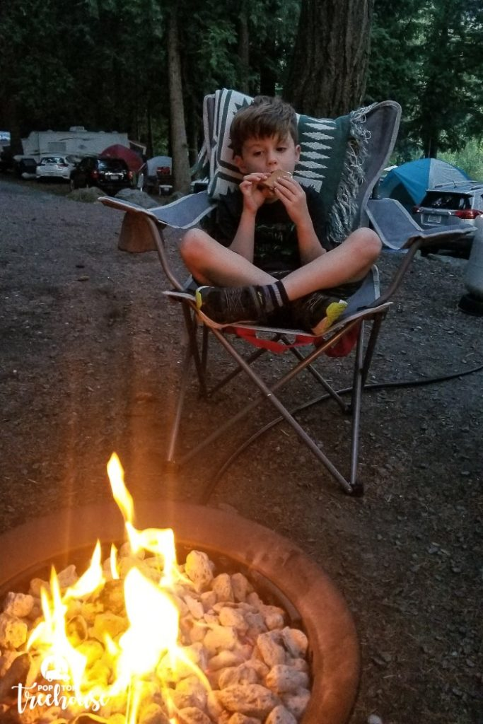 kiddo eating smores by the fire