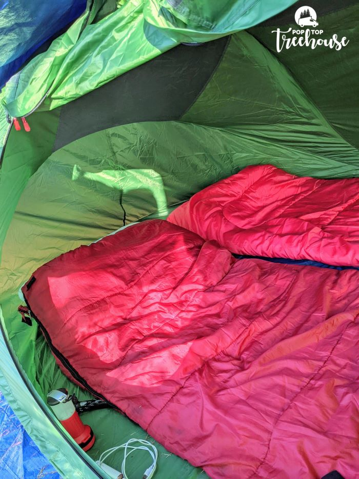 red sleeping bags in tent